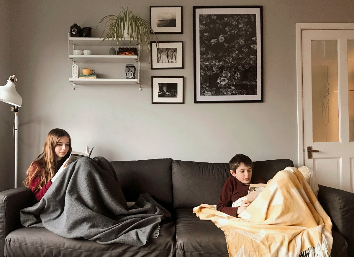 Children reading books on the sofa