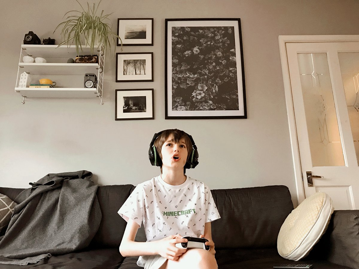 Child with headphones on gaming